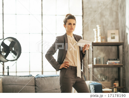 Business woman with tablet pc in loft apartment