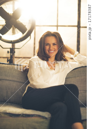 Portrait of smiling elegant young woman in loft apartment