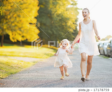 Happy mother and baby walking in city