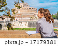 Young woman with map on embankment near castel sant'angelo in ro 17179381