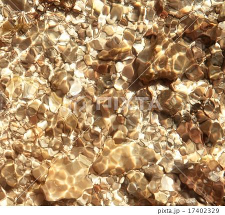Pebbles in water 17402329