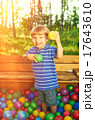 Happy child playing with colorful plastic balls 17643610