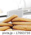 ladyfingers and cup of coffee or tea on the table 17663730