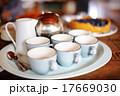 Six tea cups and a teapot 17669030