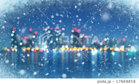 snowfall in light rays on black abstract back 17669858
