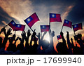 Group of People Waving Taiwanese Flags in Back Lit 17699940