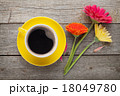 Cup of coffee and gerbera flowers 18049780