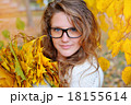 beautiful girl with glasses in autumn park with leaves 18155614