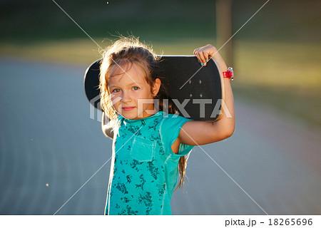 cute little girl with skateboard 18265696