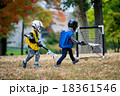 Active little kids playing lacrosse 18361546