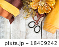 Golden wrapping paper and bow for Christmas 18409242