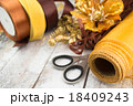 Golden wrapping paper and bow for Christmas 18409243