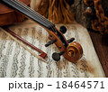 Violin head and bow on sheet music 18464571