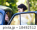 A wedding couple in old car 18492512