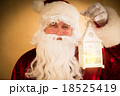 Santa Claus holding magic lantern 18525419