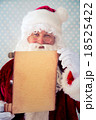 Santa Claus holding scroll paper blank 18525422