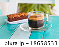 black coffee cup on white blue table 18658533