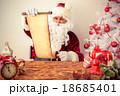 Santa Claus reading scroll 18685401