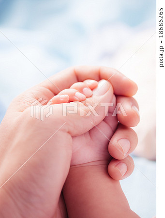 holding a hand of the newborn child tenderness