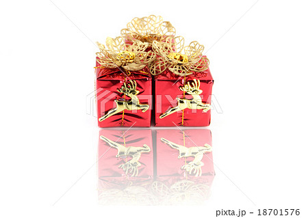 Red gift box and gold Reindeer.の写真素材 [18701576] - PIXTA