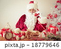 Santa Claus talking by phone 18779646
