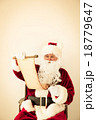 Santa Claus reading scroll 18779647