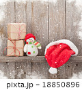 Christmas gift boxes, santa hat and snowman toy 18850896