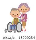 車椅子を押す仲良し老夫婦 18909234