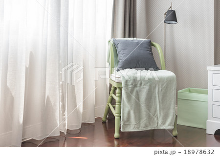 green wooden chair with grey pillow and green blanketの写真素材 [18978632] - PIXTA