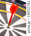 Red dart hitting the target 19032781