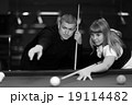 Mister training billiards and a woman 19114482