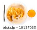 Croissant and orange juice.  19137035
