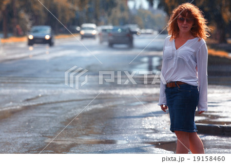 Portrait of red-haired happy woman in the rain 19158460