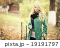 beautiful happy blond woman in autumn park 19191797
