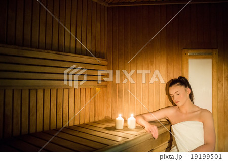 Pretty woman relaxing in the sauna 19199501