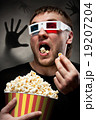 Scared man watching 3D movie 19207204