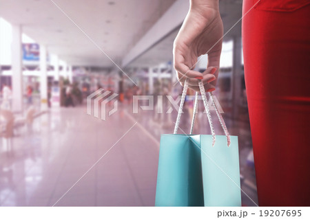 Woman with two shooping bagsの写真素材 [19207695] - PIXTA