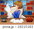 Businesswoman reading papers in office 19215163