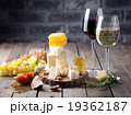 Grape, cheese, figs and honey with a glasses wine. 19362187