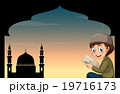 Muslim boy reading book with mosque background 19716173