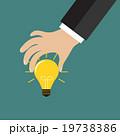 Cartoon businessman hand holding idea light bulb 19738386