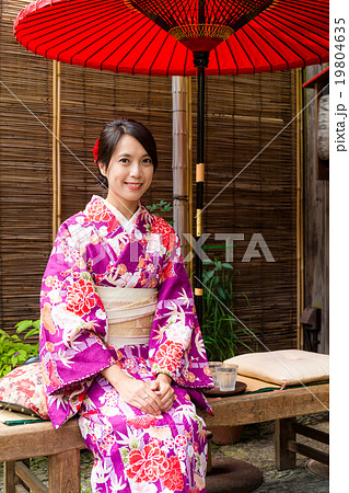 Japanese woman relaxing in tea house with kimono 19804635