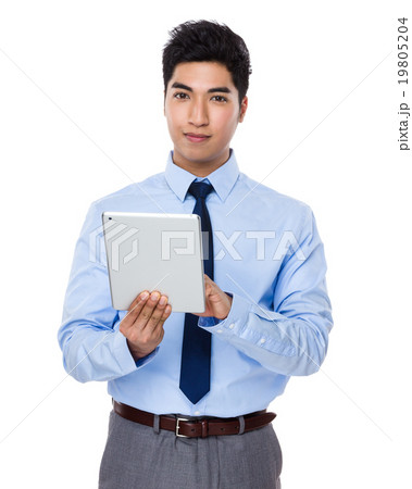 Young businessman use of the digital tablet