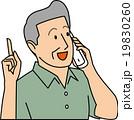 電話しながらポイントを指す50代男性 19830260