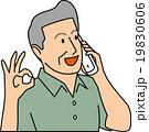 電話しながらOKサインを出す50代男性 19830606