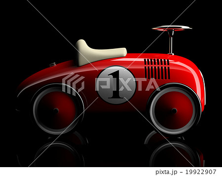 Red retro toy car isolated on black background 19922907