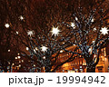 Decorated with lanterns and garlands on the trees 19994942