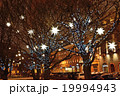 Decorated with lanterns and garlands on the trees 19994943