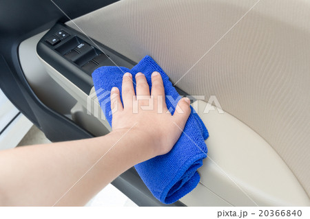 hand cleaning interior car door panel with cloth 20366840 pixta. Black Bedroom Furniture Sets. Home Design Ideas