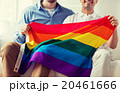close up of male gay couple holding rainbow flag 20461666